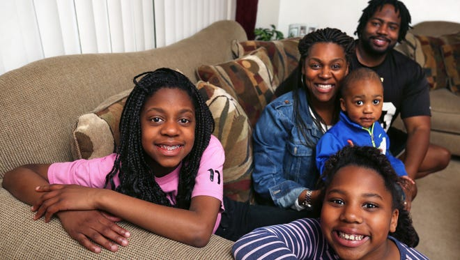 Sisters Kyra Watts (left), 12, and Olivia Watts, 8, go to after-school programs at CAFE, but their mother, Jennifer Smith, is happy to hear a new Boys & Girls Club is being built on the Far Eastside of Indianapolis. The family, including Justin Smith, 2, on his mother's lap, and Jennifer's husband, Justin Smith, are shown in their home on East 25th Street.