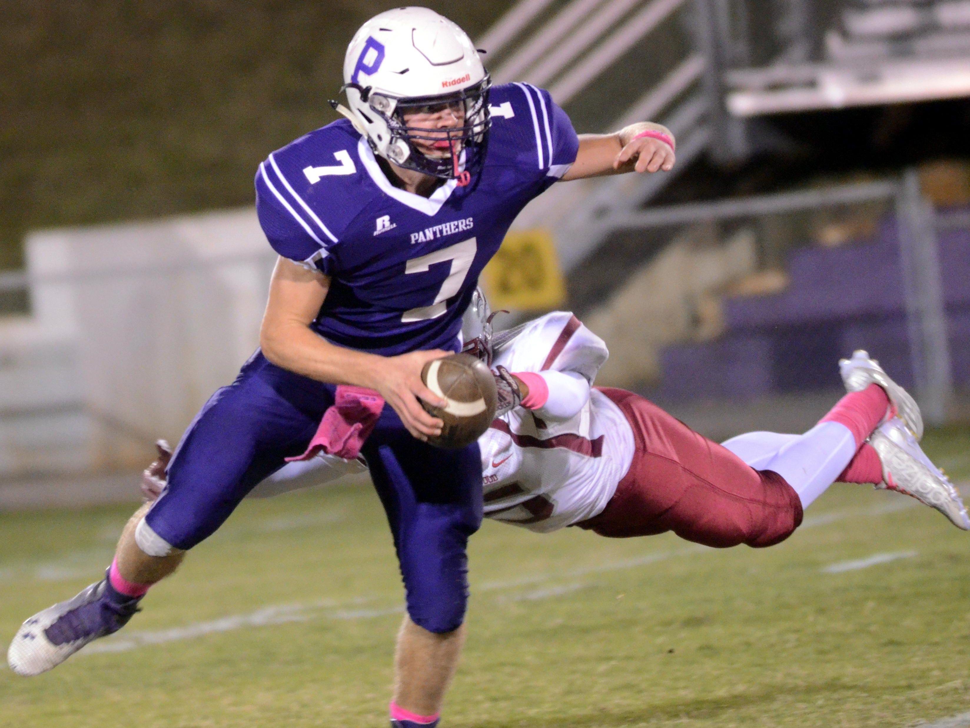 Portland High senior quarterback Ethan Brummett eludes Maplewood junior defensive back Roshawn Pointer during second-quarter action.