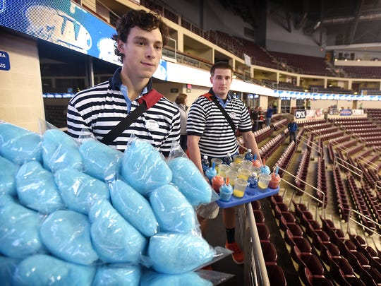 Competition is making finding vendors for Hershey events more difficult. But the way concessions are sold hasn't changed in decades and finding people to walk the steps still has some great benefits according to some seasoned pros. Kyle Ordille and Craig Griffith ready themselves for a days work at the PIAA championships.