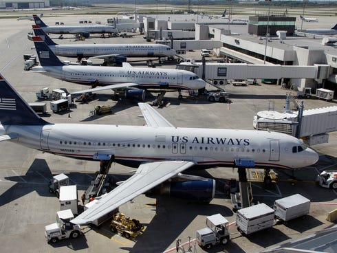 US Airways jets parked at Charlotte Douglas International Airport, one of few airports that have seen fares drop in the past eight years.