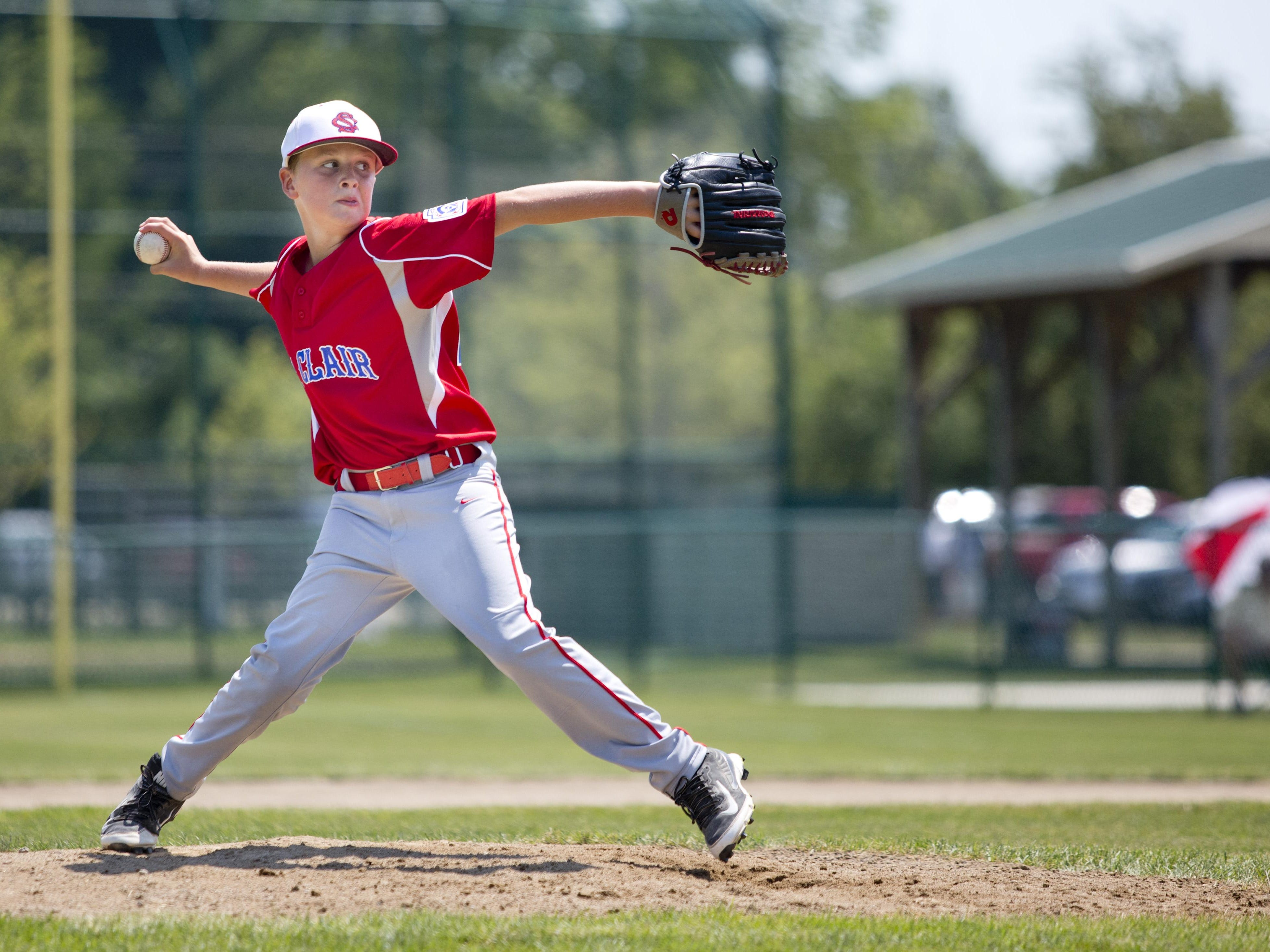 Carter Hurlburt throws a pitch during a 10-and-under state semifinal baseball game Tuesday, July 28, 2015 in St. Clair.