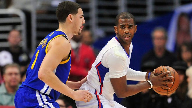 Los Angeles Clippers guard Chris Paul (3) controls the ball against Golden State Warriors guard Klay Thompson (11).