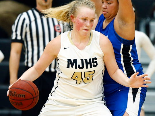 Mt. Juliet's Emma Palmer (45) drives as she's defended