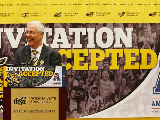Wichita State University president John Bardo smiles as he announces that the school will join the American Athletic Conference,  ending a relationship with the Missouri Valley Conference that dated back 72 years, in Wichita, Kan., Friday, April 7, 2017.  (Bo Rader/The Wichita Eagle via AP)