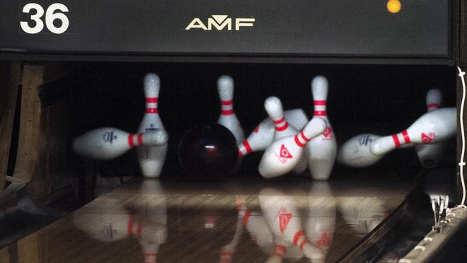 A bowling ball rips through the pins at Landmark Lanes in Peoria.