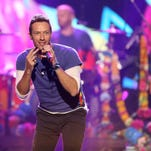 FILE - In this Sunday, Nov. 22, 2015 file photo, Chris Martin of Coldplay performs at the American Music Awards at the Microsoft Theater, in Los Angeles. Coldplay will perform at the Pepsi Super Bowl 50 Halftime Show on CBS Sunday, Feb. 7, 2016, the NFL announced on Thursday, Dec. 3, 2015. (Photo by Matt Sayles/Invision/AP, File)