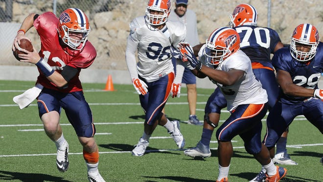 UTEP quarterback Ryan Metz, tucks the ball and takes off for a short gain during practice earlier during the week. Metz will lead the Miners on Saturday night against the Old Dominion Monarchs during UTEP's homecoming game.