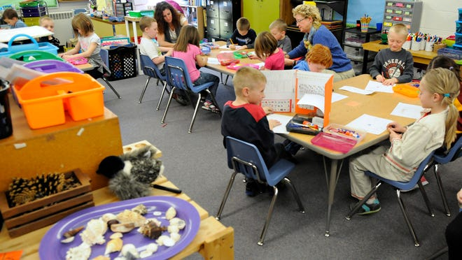 Kindergarteners finish their work at Clearview Elementary School in Clear Lake. Enrollment in the St. Cloud School District is on the rise and the board is considering a $12 million project that would add about 10 classrooms