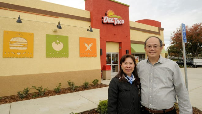 After 15 years of owning the Del Taco restaurant in the Pavilion Shopping Center at 1415 Hillman St. in Tulare, Mimi and Nicholas Yuen, pictured, have remodeled and updated the inside and outside of the restaurant. They have taken out the old children's play area and installed additional updated tables and booths. The restaurant closed Sept. 12 and reopened Wednesday.