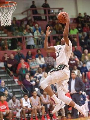 Trinity guard David Johnson prepares to dunk. Jan. 20, 2018