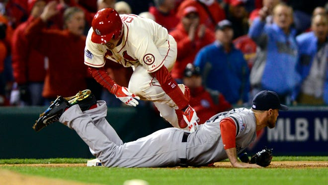 Allen Craig is tripped by third baseman Will Middlebrooks in the ninth inning and would score on an obstruction call to win Game 3.