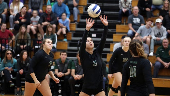 West Salem's Kasey Campbell and the Titans defeat Lake Oswego in the second round of the OSAA Class 6A state playoffs on Saturday, Oct. 29, 2016, at West Salem High School.