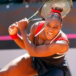 Serena Williams of United States returns the ball to