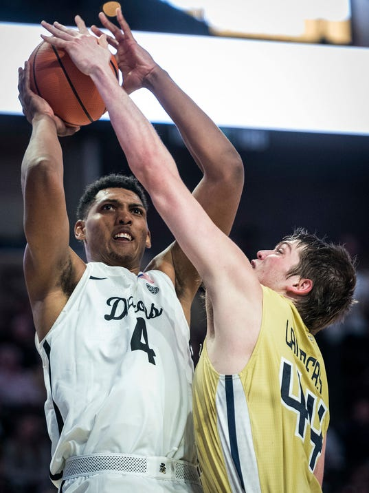 Georgia Tech center Ben Lammers (44) blocks a shot from Wake Forest center Doral Moore (4) during an NCAA college basketball game, Wednesday, Feb. 14, 2018 in Winston-Salem, N.C. (Andrew Dye/The Winston-Salem Journal via AP)