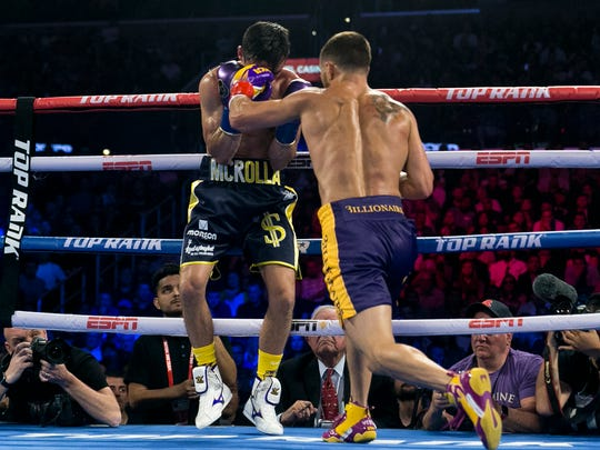 Vasiliy Lomachenko, right, connects to the face of Anthony Crolla during Friday night's fight at Staples Center.