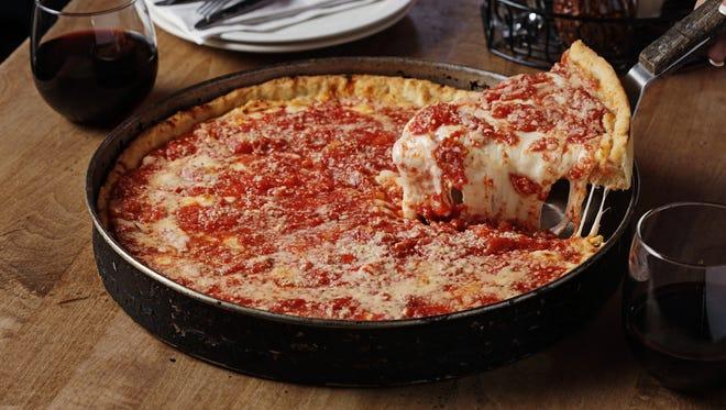 A slice of Lou Malnati's famous deep-dish pizza.