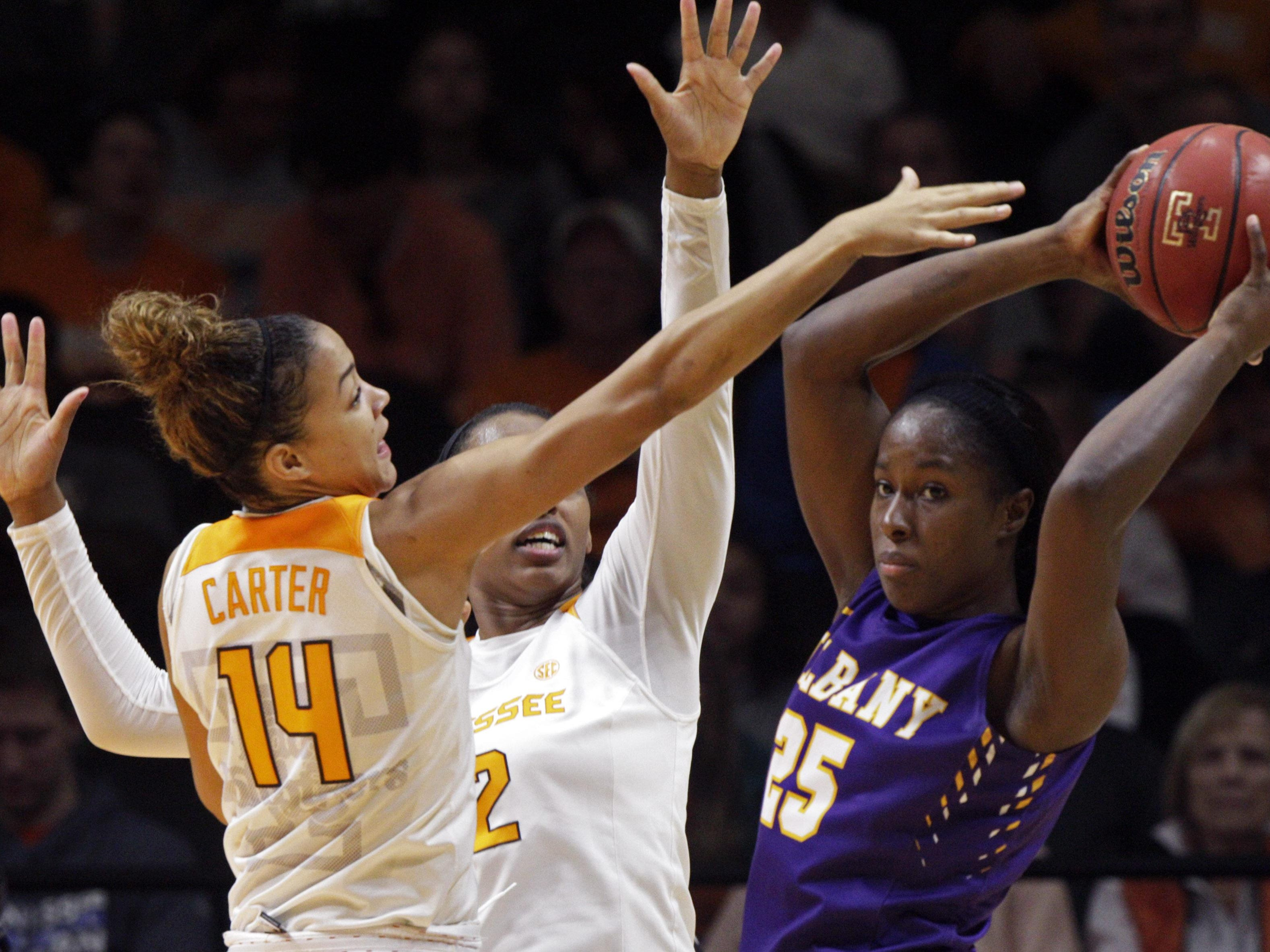 Albany forward Shereesha Richards (25) looks for help as she's pressured by Tennessee guard Andraya Carter (14) and forward Bashaara Graves on Friday.