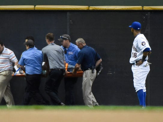 Brewers left fielder Khris Davis (18) watches medical