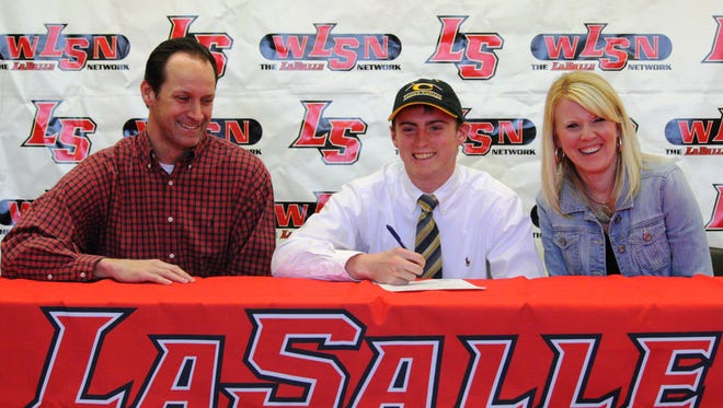 La Salle's Dylan Barnett, with his father Scott and mother Renee, signs his National Letter of Intent to play football for Centre College.
