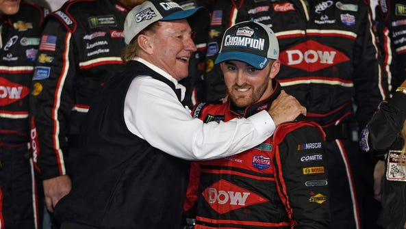 Austin Dillon, right, gets a hug from grandfather and