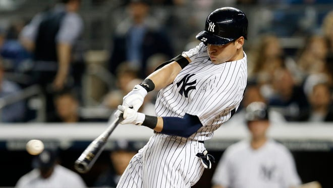 Yankees Jacoby Ellsbury takes a swing against his former team, the Boston Red Sox, at Yankee Stadium on April 13.