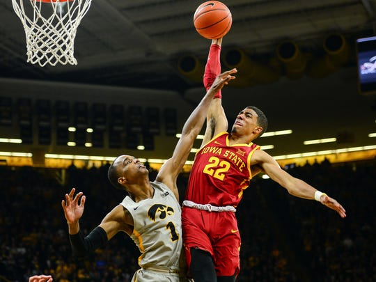 Iowa State guard Tyrese Haliburton, right, goes to the basket as Iowa guard Maishe Dailey defends.