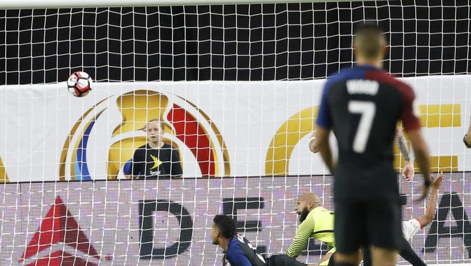 U.S. defender DeAndre Yeldin (2) and U.S. goalkeeper Tim Howard (12) watch a goal by Colombia hit the net during the first half of the Copa America Centenario third place game at University of Phoenix Stadium in Glendale, Ariz. June 25, 2016. The U.S. lost 1-0.