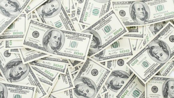 A pile of hundred dollar bills.