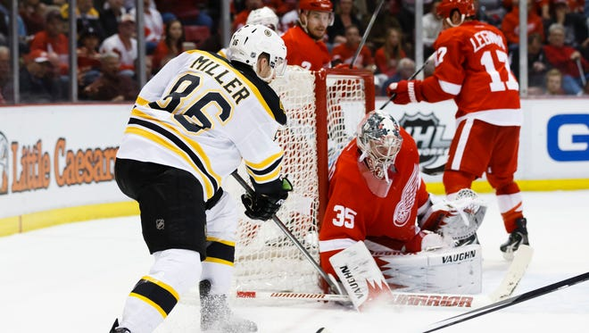 Detroit Red Wings goalie Jimmy Howard (35) makes a save on Boston Bruins defenseman Kevan Miller (86) in the second period at Joe Louis Arena.