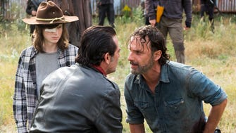 Enemies Negan (Jeffrey Dean Morgan), center, and Rick, right, seen here with Carl (Chandler Riggs) in last season's finale, are still at odds in Season 8 of AMC's 'The Walking Dead.'