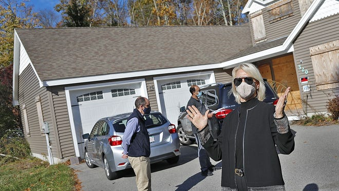 Auctioneer Marianne Sullivan asks for bids on the home behind her, lowering the minimum bid to $2,500.  Rockland officials try to auction a home on Concord Street. The home was built improperly on an undersized lot. No bidders bought the house on Thursday November 5, 2020  Greg Derr/ The Patriot Ledger