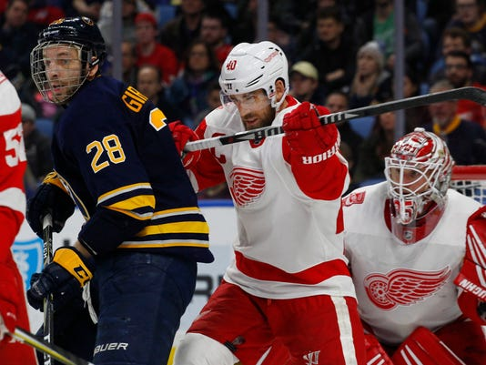 Buffalo Sabres Zemgus Girgensons (28) is cross-checked by Detroit Red Wings Hentik Zetterberg (40) during the third period of an NHL hockey game Thursday, March 29, 2018, in Buffalo, N.Y. (AP Photo/Jeffrey T. Barnes)