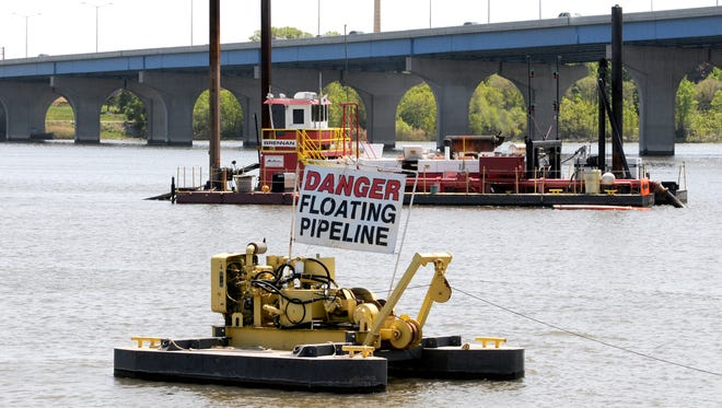 A dredging unit works on the Fox River near Wisconsin 172 as part of the PCB removal project.