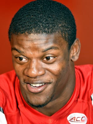 Louisville quarterback Lamar Jackson answers a reporters question during Louisville Football Media Day, Saturday, Aug. 5, 2017 in Louisville Ky.