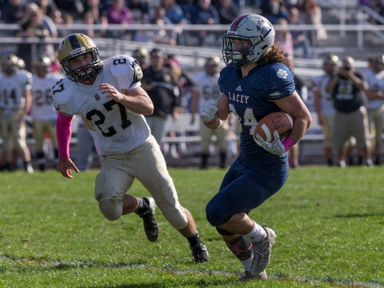 Lacey's Jason Giresi takes the ball around left end heads to the endzone for his team's second touchdown of game. Southern Regional football vs Lacey in Lacey NJ on October 28, 2017.