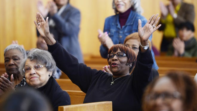 Anita Glasker, 64, of Plymouth shows her approval during the praise and singing portion of the Good Friday service at Hope United Methodist Church in Southfield.