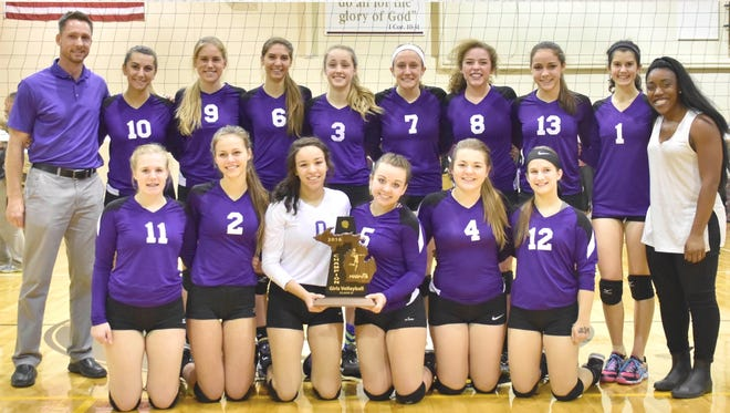 Celebrating its Class D district title Friday is Plymouth Christian Academy's volleyball team.