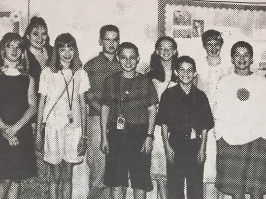 The UCMS top Accelerated Readers for sixth grade in June 2001 were, front from left, Courtney Travis, Ashley Humphrey, Charlie Harris, Cody Farthing, and Jake Marshall. Back, Cassie Rzepka, Marianne Carroll, Davis Hunter, Amanda Huff, Brittani Baird, and Hadley Goodman.