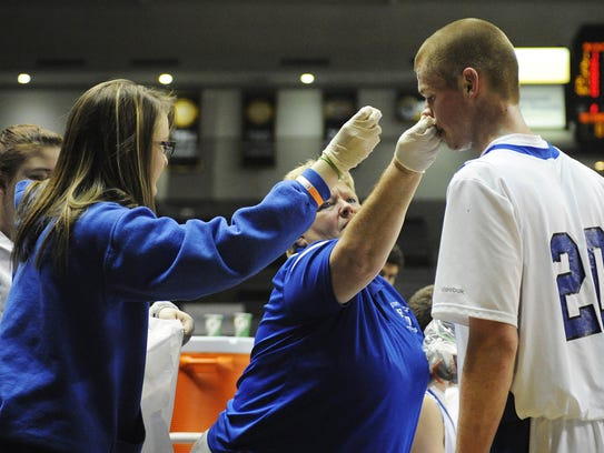 Fort Defiance athletic trainer Becky Anhold cleans