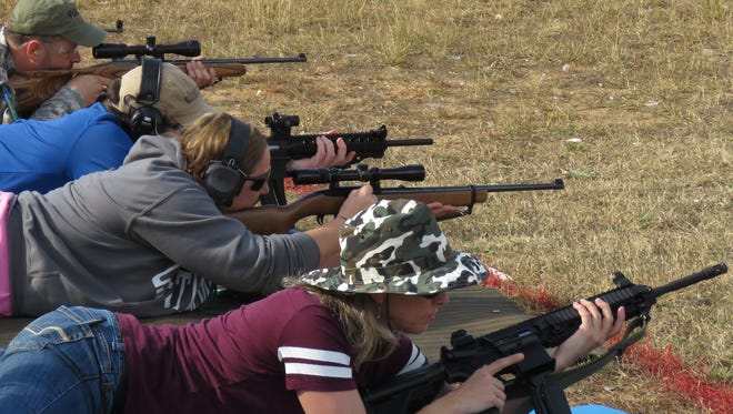 Students practice their marksmanship and gun safety during the Project Appleseed gun safety and marksmanship training Saturday at the Escambia River Gun Club.