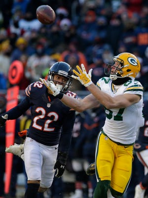 Green Bay Packers wide receiver Jordy Nelson (87) reels in  60-yard pass while being covered by Chicago Bears cornerback Cre'von LeBlanc at Soldier Field.