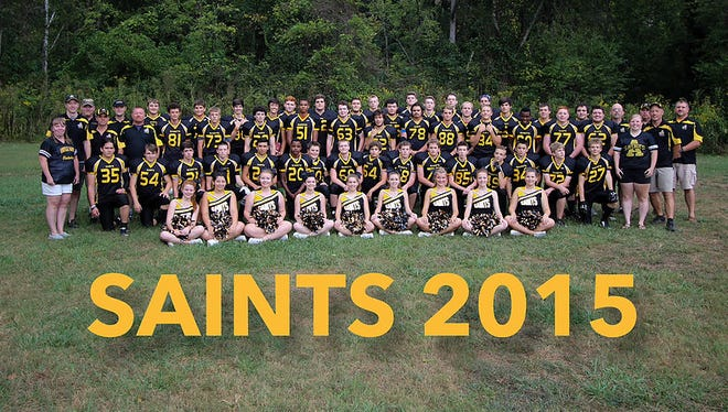 Last year's Asheville Saints football players and cheerleaders.