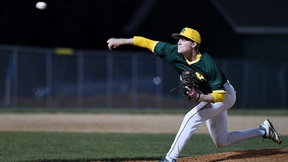 Josh Dotson pitches in the game against Asheville April