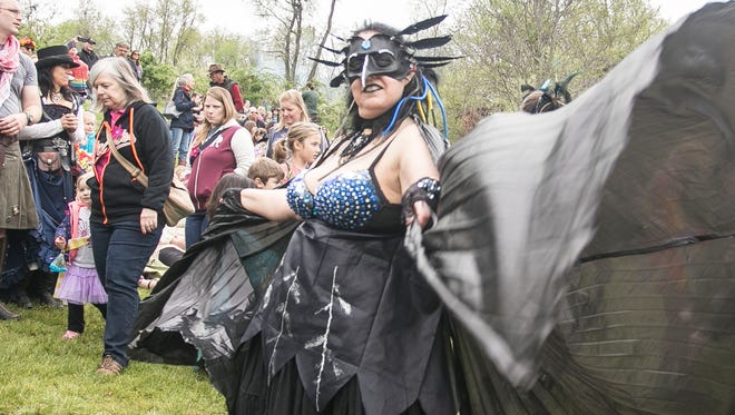 Dressed as a Raven spirit, Devon McLaughlin, of Stewartstown, dances to Cu Dubh at the 25th Annual Fairie Festival Saturday, April 30, 2016, at Spoutwood Farm in Codorus Township. Amanda J. Cain photo