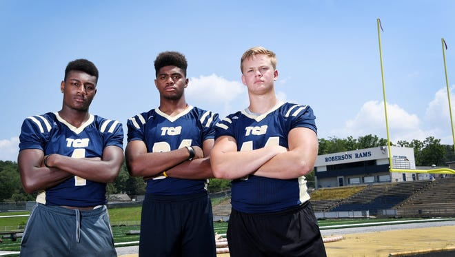 Roberson football players, from left, Barshia Young, Jordan McNeill and Greg Johnston.