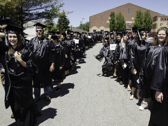 CCV graduates line up outside the Kreitzberg Arena at Norwich University on Saturday.