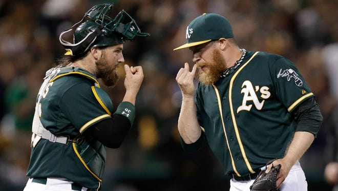 Oakland's Sean Doolittle, right, and Derek Norris celebrate after the A's 2-1 win over Angels on Saturday, in Oakland, Calif. Doolittle went on the disabled list on Sunday.