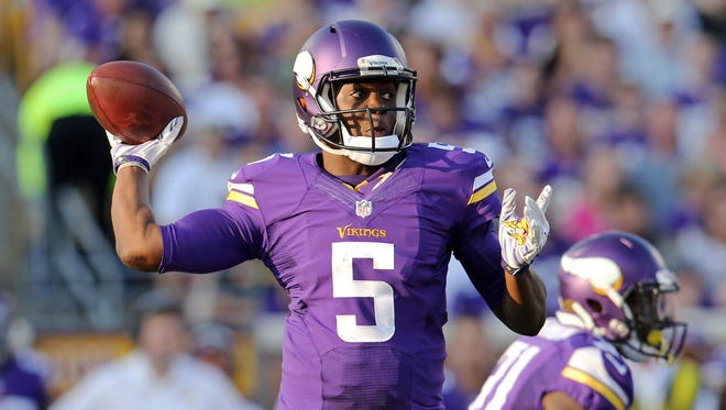 Minnesota Vikings quarterback Teddy Bridgewater (5) throws during the third quarter against the Atlanta Falcons at TCF Bank Stadium.