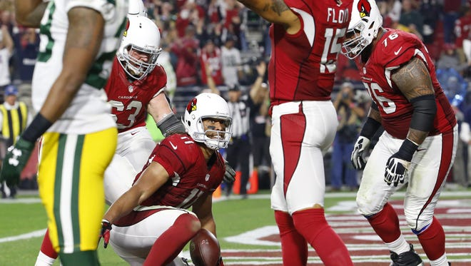 Cardinals' Larry Fitzgerald (11) celebrates his game winning touchdown against the Packers in overtime during 2016 NFC Divisional Playoff Game at the University of Phoenix Stadium in Glendale, Az., on Saturday, January 16, 2016.