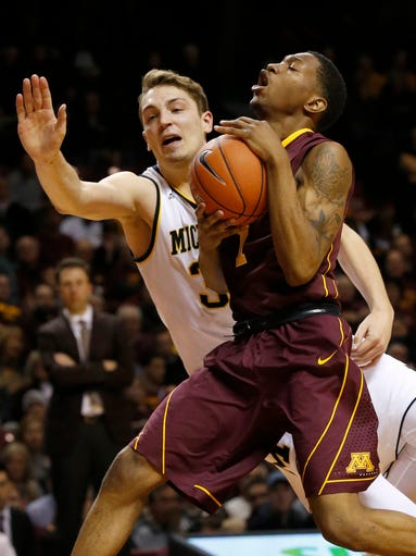 Minnesota guard Dupree McBrayer, right, collides with